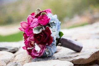 bridesmaid-bouquet-with-light-blue-hydrangea-pink-rose-red-rose-and-burgundy-orchid