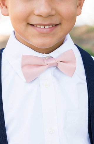 brides-son-pink-bowtie-ring-bearer-navy-suit-little-boy-catholic-wedding