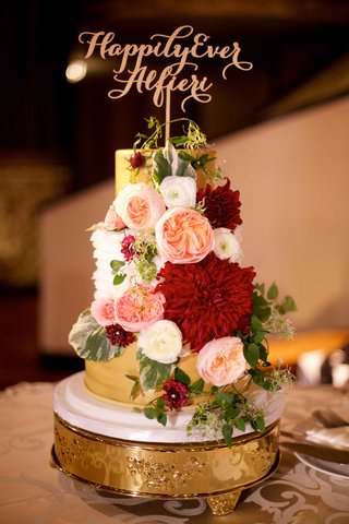 wedding-cake-gold-with-white-ruffle-layer-happily-ever-after-cake-topper-and-fresh-flowers-red-blush