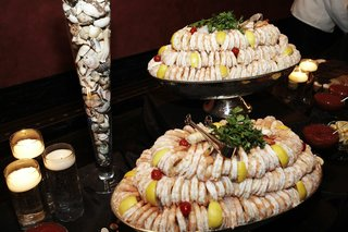 tiered-stand-filled-with-shrimp-at-wedding-reception