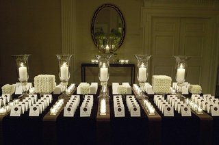 white-place-card-display-with-candles-and-mums