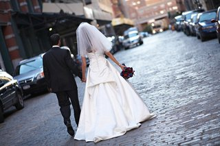 bride-and-groom-walk-down-city-street