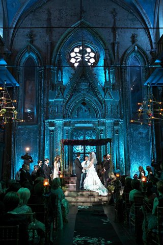 venue-with-high-ceilings-and-gothic-architecture-lit-with-blue-lighting