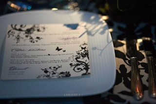 menu-card-on-white-plate-with-green-and-purple-floral-design