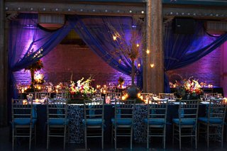 turquoise-table-with-centerpieces-of-flowers-and-branches