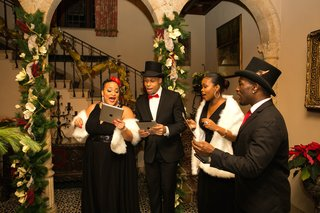 holiday-wedding-with-african-american-carolers-in-tuxes-black-dresses-at-chateau-pleasantdale