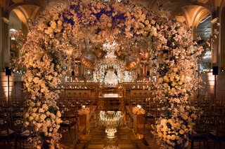 the-plaza-hotel-wedding-ceremony-flower-arches-over-mirror-aisle-opulent-ceremony-decor