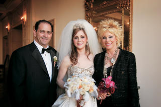 bride-in-regal-wedding-dress-with-mom-and-dad