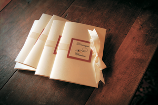 ceremony-booklets-fastened-with-ribbon