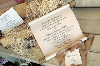 regal-scroll-invites-in-gold-box-with-raffia
