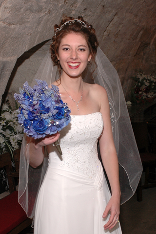 bride-in-scottish-castle-in-strapless-white-wedding-dress-and-blue-bouquet