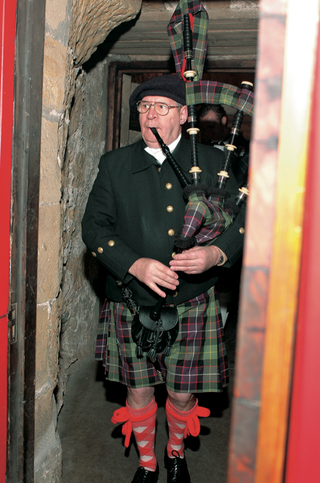 scottish-bagpiper-playing-bagpipe-in-castle