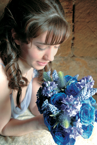 bridesmaid-holding-all-blue-bouquet-with-rare-flowers