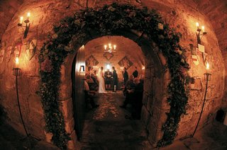 dark-castle-wedding-ceremony-decorations-in-cave-like-room