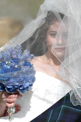 bride-with-veil-over-face-and-blue-bouquet