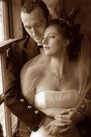 sepia-tone-picture-of-couple-in-scotland-castle-wedding-venue