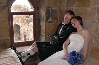 groom-in-kilt-with-bride-inside-scottish-castle