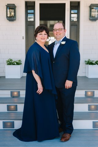 groom-with-glasses-in-navy-suit-and-fun-bow-tie