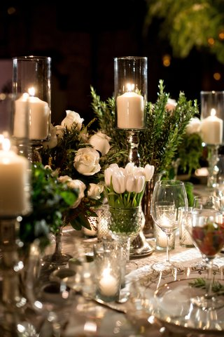 tablescape-with-vases-of-white-roses-white-tulips-and-candles
