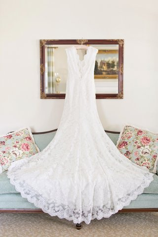 watters-alencon-lace-gown-with-cap-sleeves-v-neckline-scalloped-hem-court-length-train-on-hanger