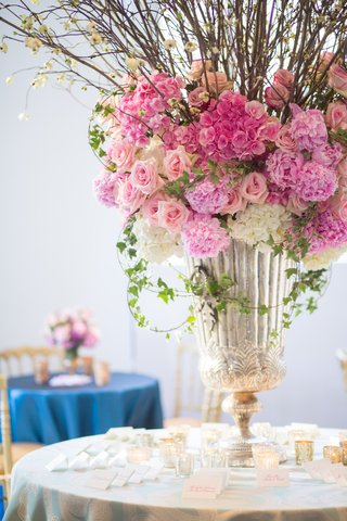 heirloom-silver-urn-filled-with-bright-pink-flowers