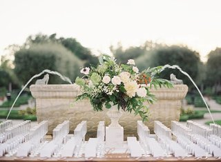 outdoor-wedding-reception-escort-card-table-with-laser-cut-details-and-champagne-glasses-neutral