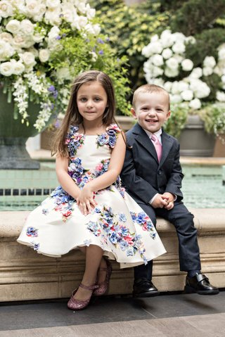 sweet-little-girl-in-flower-print-dress-and-boy-in-suit-with-pink-tie-for-50th-anniversary-party