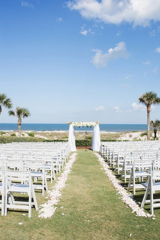 amelia-island-florida-wedding-on-lawn-with-palm-trees-and-ocean-view