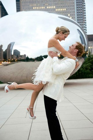 bride-in-a-short-dress-and-groom-in-a-tuxedo-with-a-white-coat-and-black-pants
