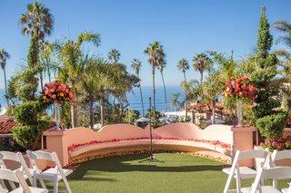 vibrant-seaside-ceremony-venue-florals-la-valencia-hotel-la-jolla-california-spanish-influences
