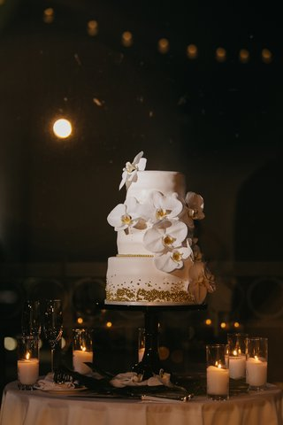 three-tier-wedding-cake-with-fondant-orchids-gold-pearl-sprinkles