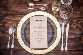 hammered-gold-rimmed-glass-charger-farm-table-silverware-wedding-menu