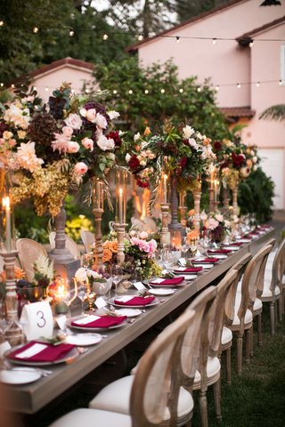 wedding-reception-outdoor-long-table-wood-cane-chair-tall-centerpiece-fall-wedding-ideas-greenery