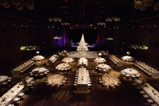 view-from-above-indoor-wedding-reception-with-each-table-carefully-lit