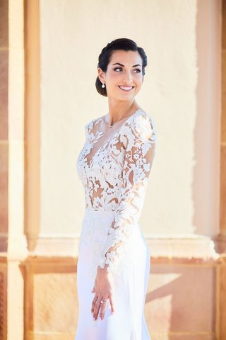 bride-in-pronovias-wedding-dress-with-lace-bodice-crepe-skirt-low-updo-with-braids-natural-makeup