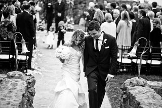 black-and-white-photo-of-bride-and-groom-leaving-ceremony