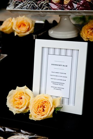 striped-dessert-menu-at-wedding-with-yellow-roses
