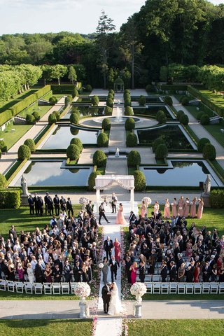 wedding-recessional-on-grounds-of-oheka-castle-in-huntington-new-york