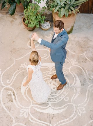 welcome-party-rehearsal-dinner-destination-wedding-grey-suit-brown-shoes-bride-in-white-dress-lotus