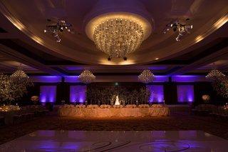 ballroom-wedding-with-purple-lighting-cake-and-custom-dance-floor