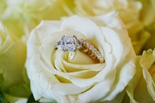 wedding-jewelry-engagement-ring-and-wedding-band-diamond-in-white-rose-flower