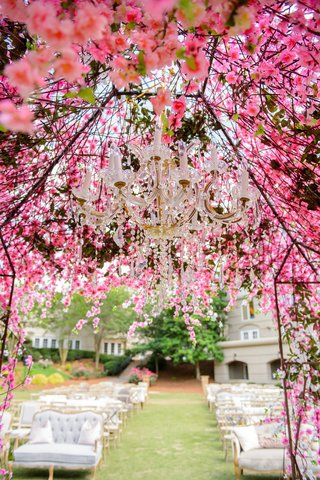 wedding-ceremony-outdoor-lounge-seating-and-vineyard-chairs-pink-flower-chuppah-chandelier