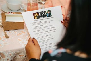 bridal-shower-guest-reading-bridal-shower-game-instructions-with-multiple-choice-questions
