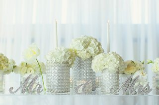 white-wedding-reception-with-white-hydrangeas-in-beaded-glass-vases-and-crystal-mr-mrs-signs