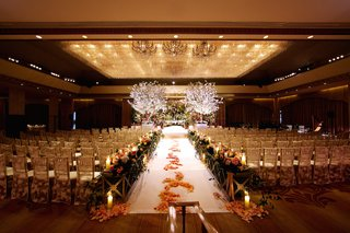 indoor-wedding-with-lace-chair-covers-and-petals