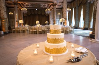three-tier-white-wedding-cake-with-gold-sequin-details