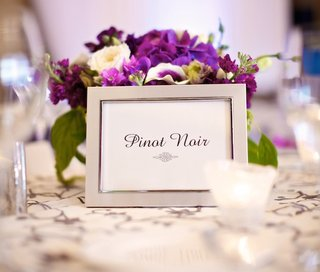 pinot-noir-table-label-in-silver-frame-with-purple-centerpiece