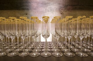 row-of-champagne-flutes-rimmed-with-gold-sugar