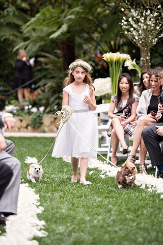 flower-girl-with-babys-breath-flower-crown-and-silver-belt-walks-small-dogs-down-the-aisle