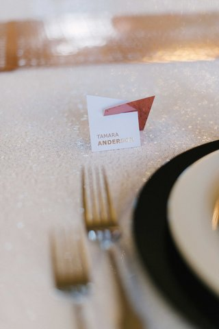 small-contemporary-style-escort-card-on-a-shimmering-white-table-linen